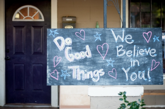 That's our house, and that's a sign that we posted on the front porch for the first day of school, August 25.